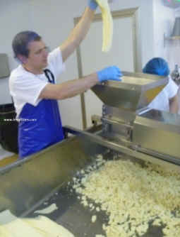 Hafod cheddar cheese being milled