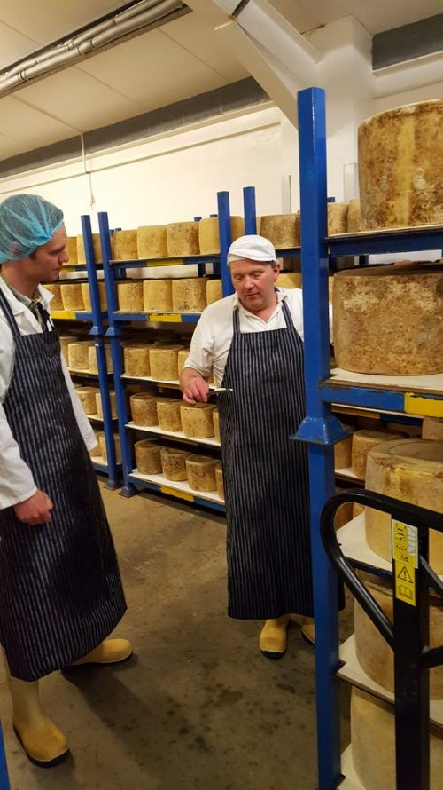 Graham Kirkham selecting Lancashire cheese