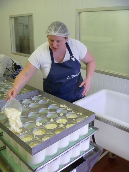 Ladling tunworth soft cheese